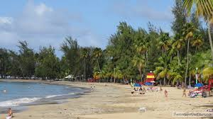 LUQUILLO BEACH If you want a safe place with a beautiful view of the ocean with an awesome backdrop of El Yunque, this is the place. Cool, tranquil waters (very safe for young children) with places to camp (reservation required) and decent shops to eat